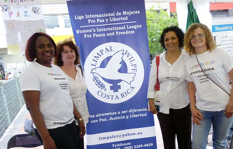 WILPF members Pascaline Ngon'ba, Ana Mondrus, Adilia Caravaca and Carolyn Ross at their Drawing for Peace project booth at the Peace Festival in Costa Rica.