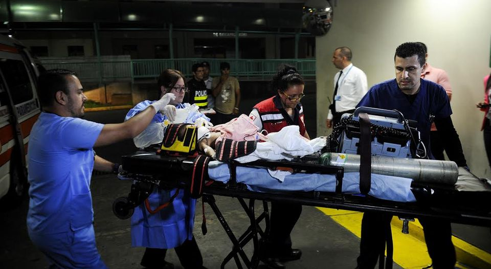 Paramedics rushed the six month old infant to hospital after crashing through the windshield of the car that killed her mother. The baby died minutes later in hospital. Photo Rafael Murillo, La Nacion