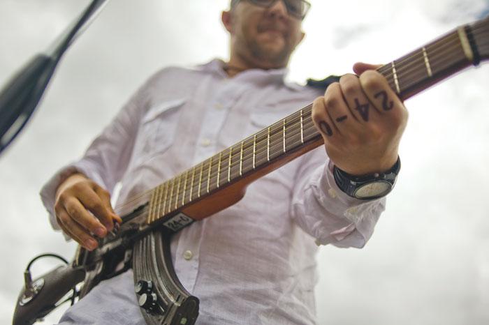 César López plays an Escopetarra at Bolívar Square in Bogotá
