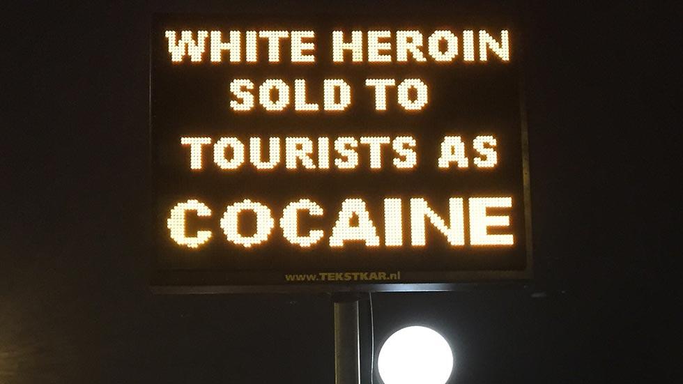 heroinsign
