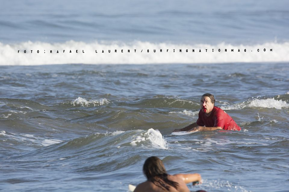 Surfer victim paddling to shore on his surfboard. Photo Rafael Laurent, Surfingnationmag.com