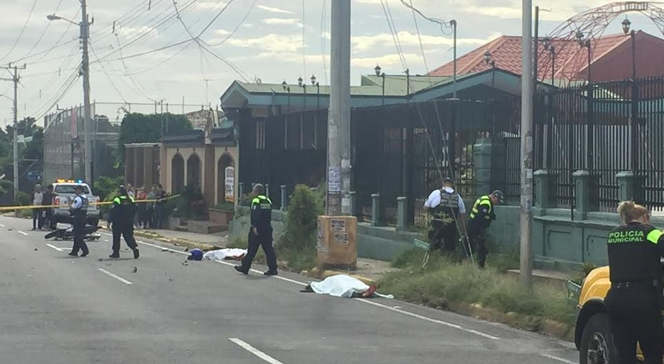 The scene in San Franisco de Heredia Sunday afternoon police securing the site of the accident