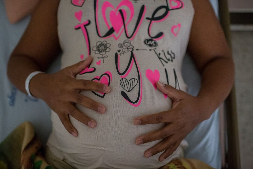 Gloria Golú, 41, holds her belly at University Hospital of Valle, in Cali, Colombia, last month. Golú is carrying her third child and is infected with the Zika virus. (Eduardo Leal/For The Washington Post)
