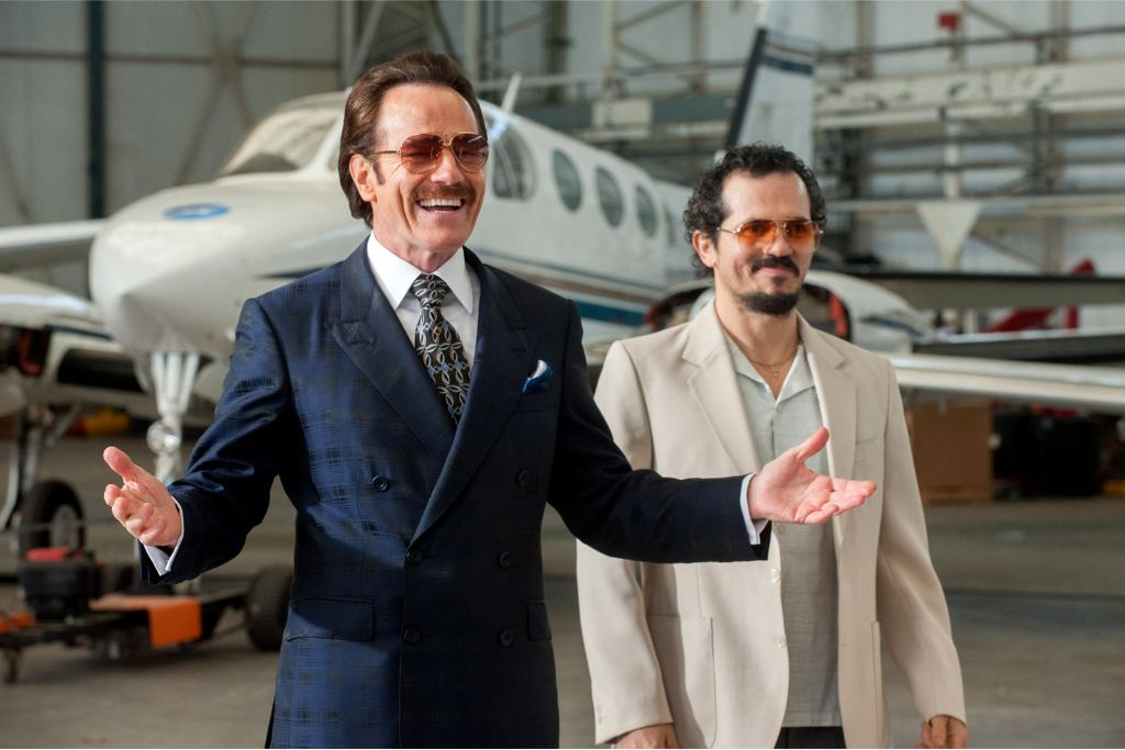 Bryan Cranston (L) as undercover U.S. Customs agent Robert Mazur and John Leguizamo (R) as his partner Emir Abreu in THE INFILTRATOR, a Broad Green Pictures release. Credit: Liam Daniel / Broad Green Pictures