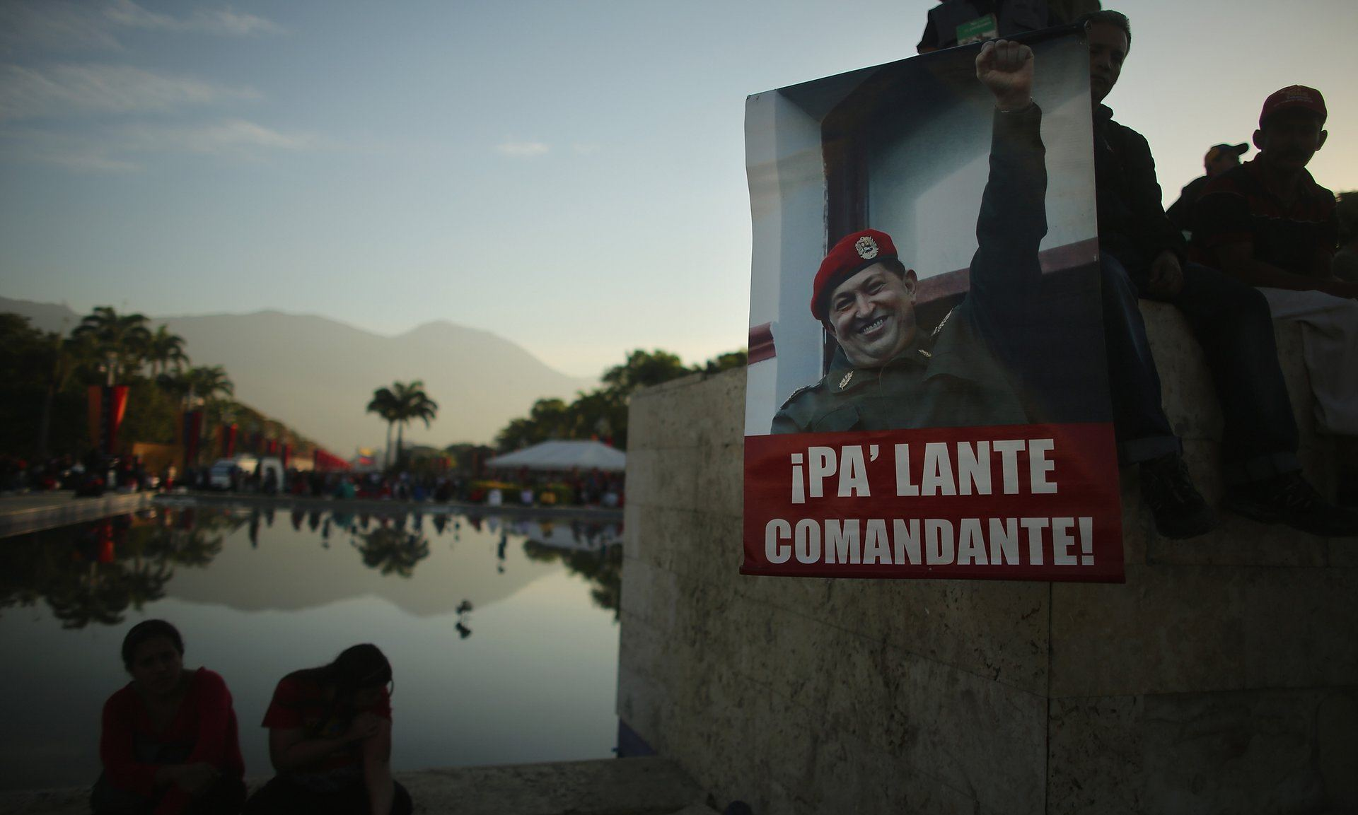 People gathered before the start of Hugo Chávez's funeral in Caracas, Venezuela. Photograph: Mario Tama/Getty Images