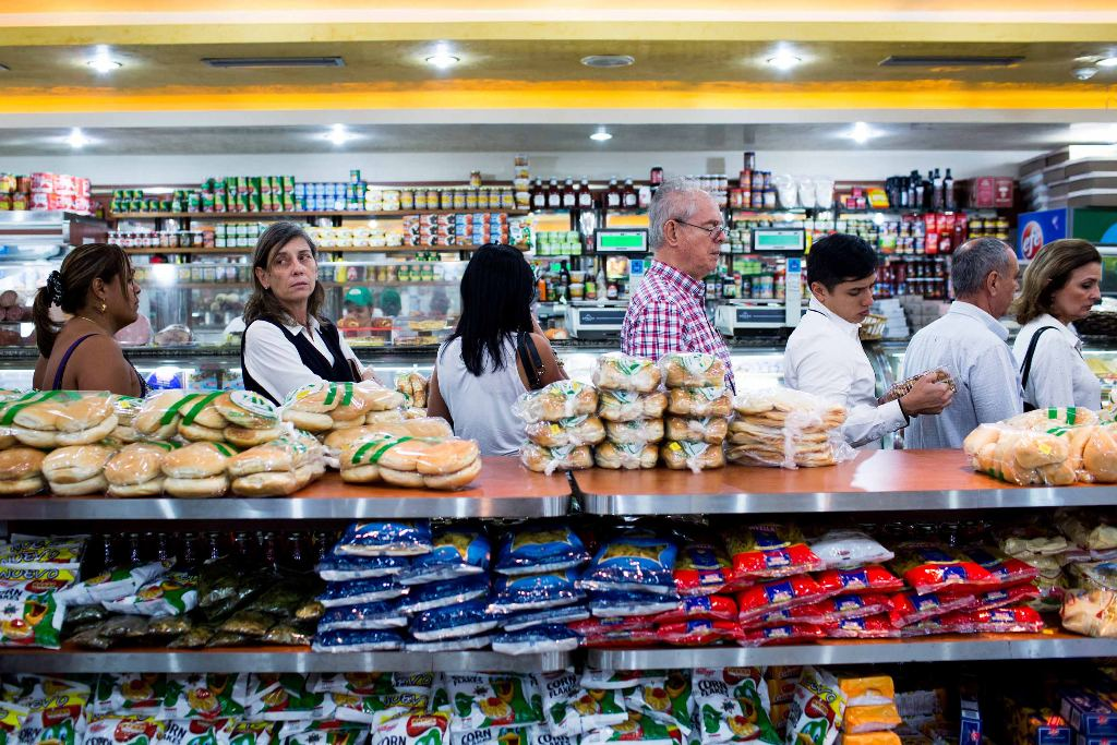 Store shelves that are well-stocked, like those in this bakery near Zerpa's house, are typically full of non-essential items set at sky-high prices.
