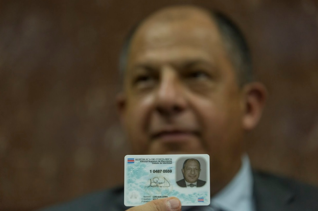President Luis Guillermo Solis holding his new cedula.