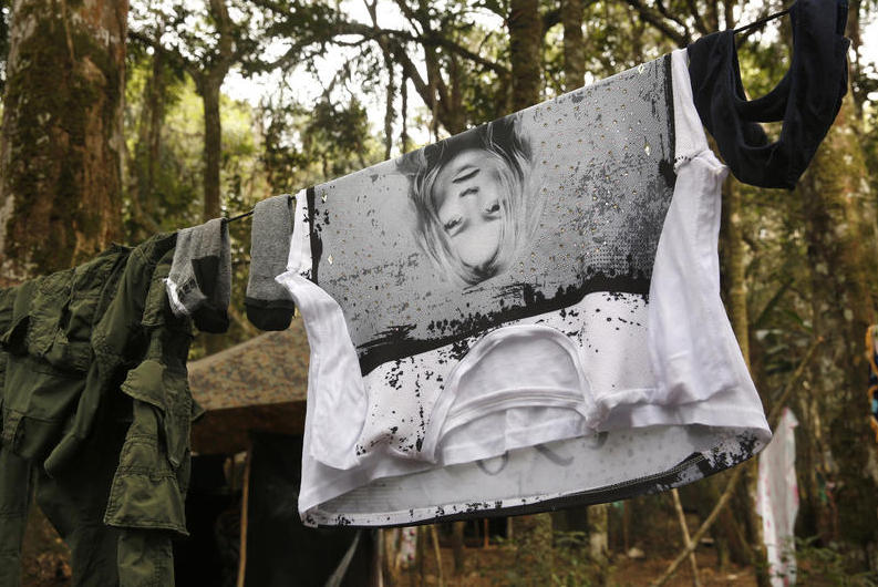 A Kate Moss T-shirt dries on a clothesline alongside a FARC uniform in Colombia's Yari Plains, a key rebel stronghold.