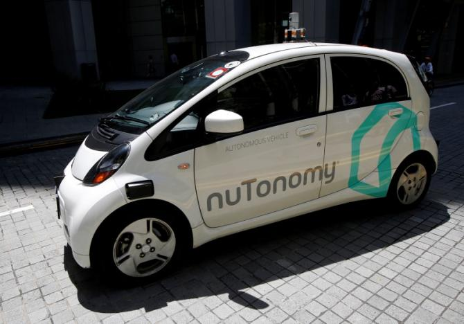 A nuTonomy self-driving taxi drives on the road in its public trial in Singapore August 25, 2016. REUTERS/Edgar Su