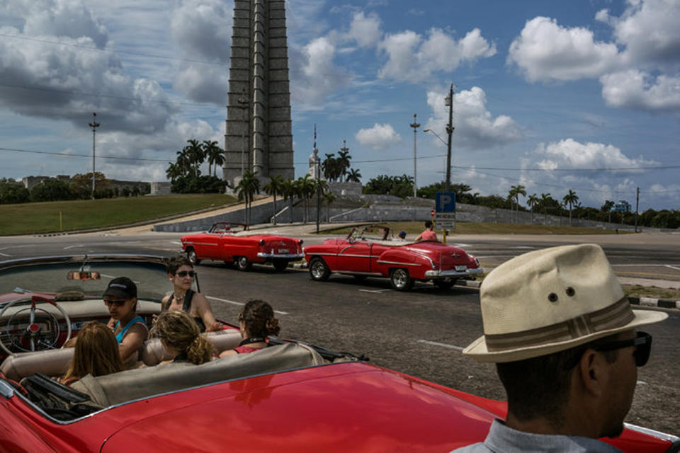 Tourists wait for the driver for a car tour around Revolution Square in central Havana. Credit Mauricio Lima for The New York Times