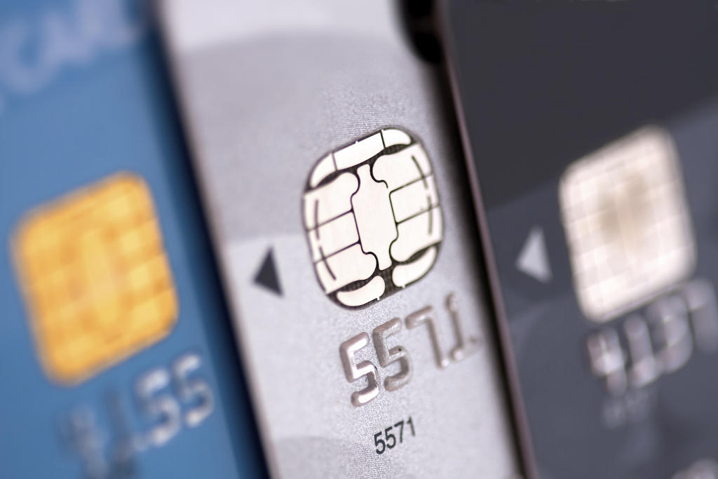 """EMV cards are smart cards (also called chip cards or IC cards) that store their data on integrated circuits in addition to magnetic stripes. These include cards that must be physically inserted (or """"dipped"""") into a reader and contactless cards that can be read over a short distance using radio-frequency identification (RFID) technology. Payment cards that comply with the EMV standard are often called Chip and PIN or Chip and Signature cards, depending on the authentication methods employed by the card issuer."""