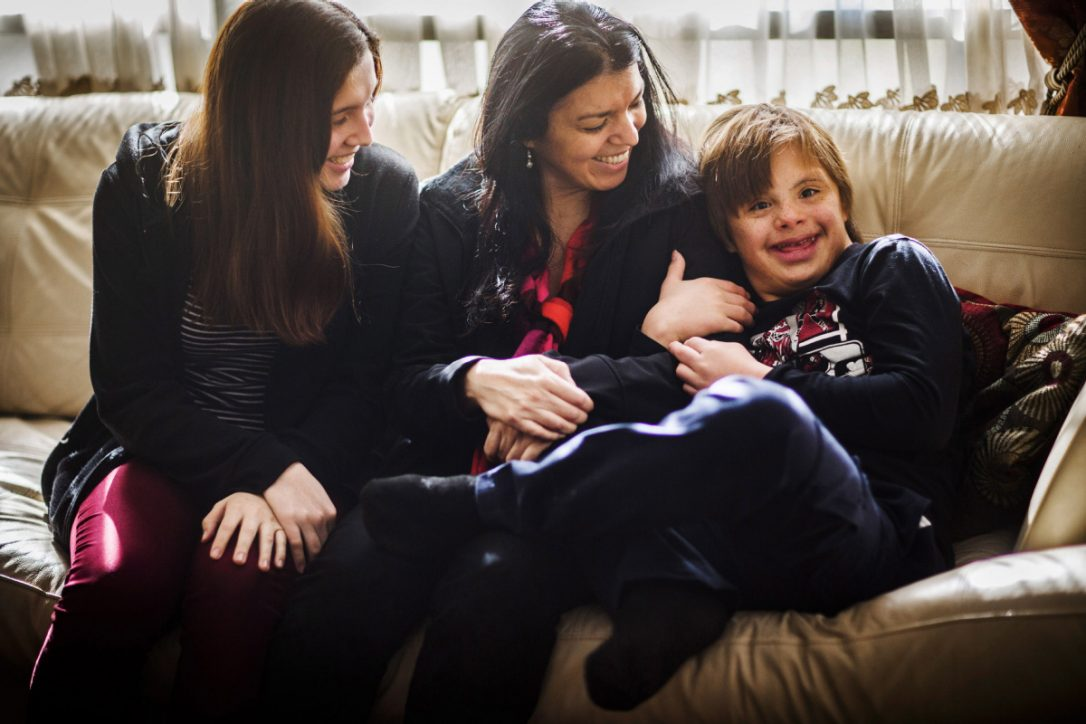 York University professor Felipe Montoya and his family were denied permanent residency because of 13-year-old son Nicolas's Down syndrome. Nicolas is pictured here, right, with his mother Alejandra Garcia and his sister Tania. (Mark Blinch / THE CANADIAN PRESS)