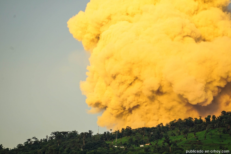 The golden cloud of ash is due to the rising sun.
