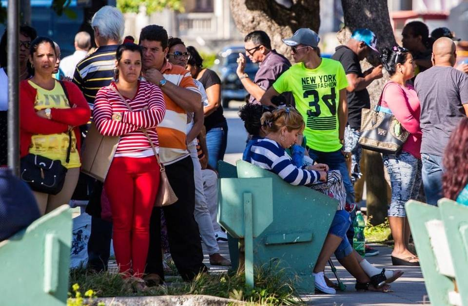 People wait for visas outside the U.S Embassy in Havana, the day after Republican presidential candidate Donald Trump defeated Democrat Hillary Clinton. Desmond Boylan AP