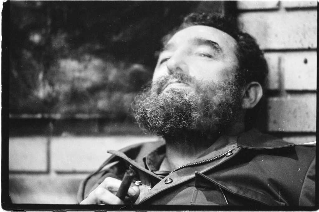 HAVANA, CUBA -- DECEMBER 1979: Fidel Castro smokes a cigar in his office, December 1979, in Havana, Cuba. He was being interviewed by Time Magazine's Editor-in-Chief, Henry Grunwald. (Photo by David Hume Kennerly/Getty Images)