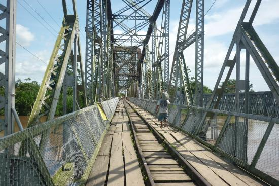 The old train bridge shown in the picture is no longer in use. There was a temporary bridge built right next to it.