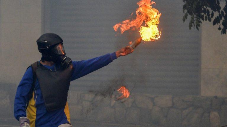 Protesters in Venezuela burn Hugo Chavez's childhood home
