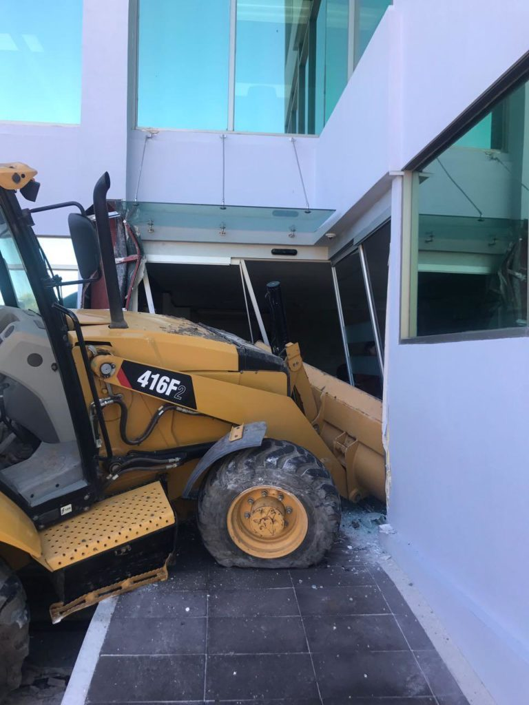 Outraged, Man Slams Backhoe Into Building Owing Debt