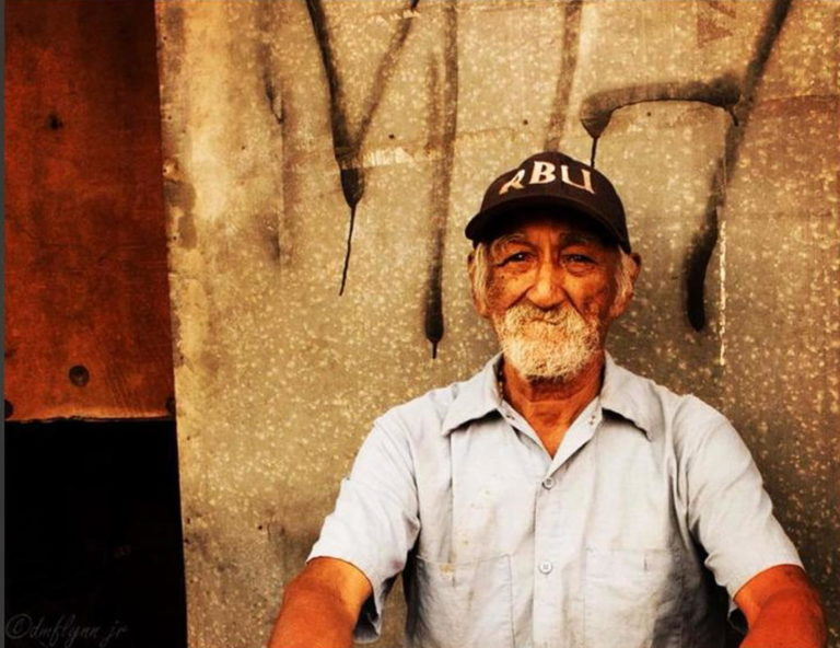 American Expat with Photography Exposition in San José