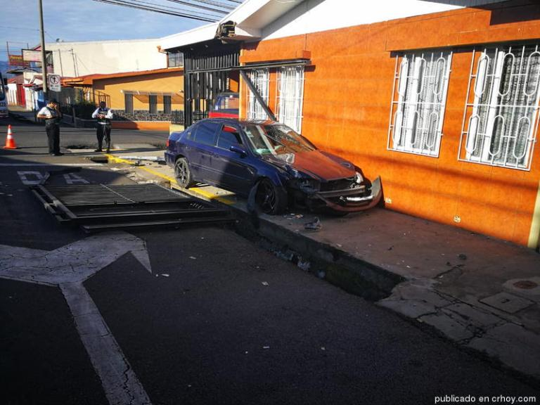 Car Loses Control, Slams Into House, Driver and Passenger Get Into Scuffle, Shots Fired (Video)