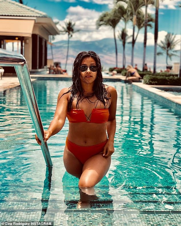 Gina Rodriguez modeling a playful bikini during vacation in Costa Rica