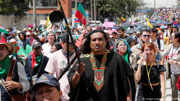 Tens of thousands march in third strike