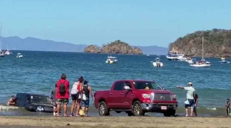Car Stuck On Beach At Playas Del Coco