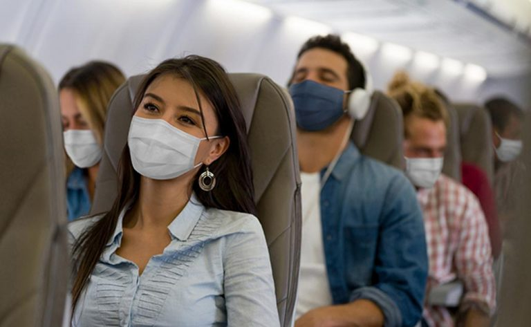 What is the risk of contracting COVID-19 on board a flight?