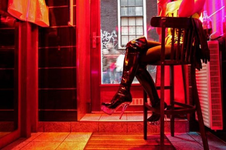 Business heats up again with the return of sex workers in Amsterdam after six 'boring' months off due to Covid