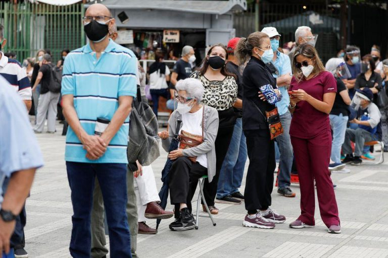 Long lines and confusion as Venezuela begins COVID-19 vaccination